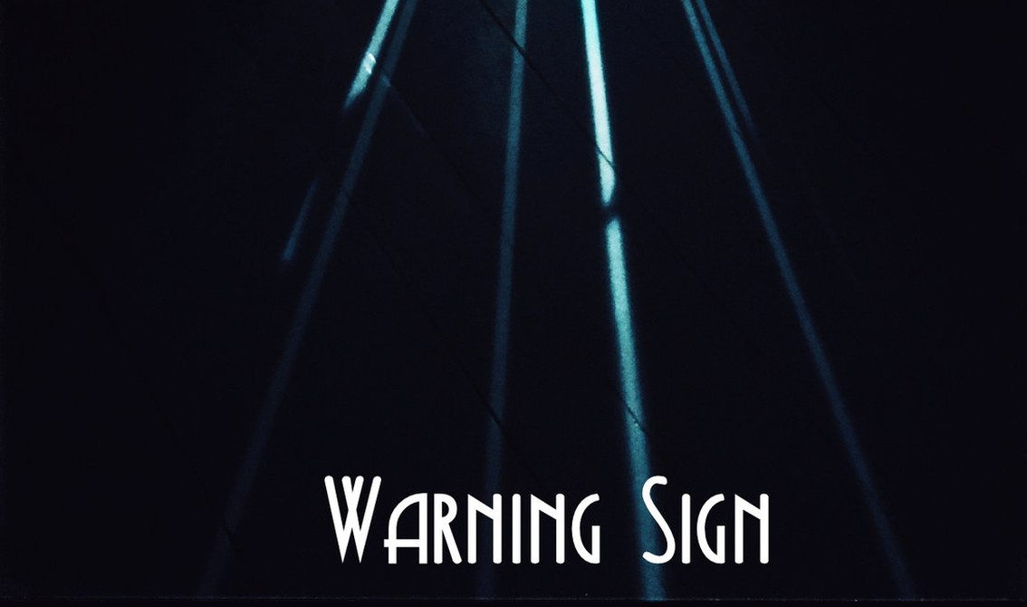 Black Needle Noise returns with 'Warning Sign' track featuring Kendra Frost